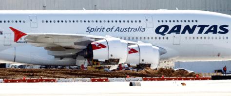 Image: A Qantas A380 jumbo jet sits idle on the tarmacc