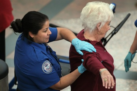 Image: TSA screens passengers at Denver International Airport