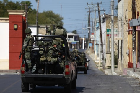 Image: Mexican army soldiers patrol the streets in Ciudad Mier
