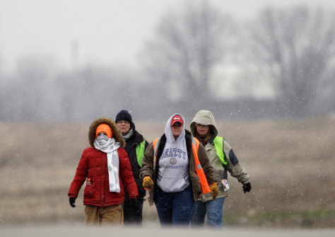 Image: Volunteers search a field in Williams Countynear Pioneer, Ohio