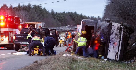 Image: Emergency workers respond to a bus rollover