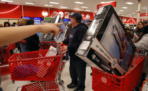 Image: A Target store employee directs shoppers on Black Friday in Lanesborough