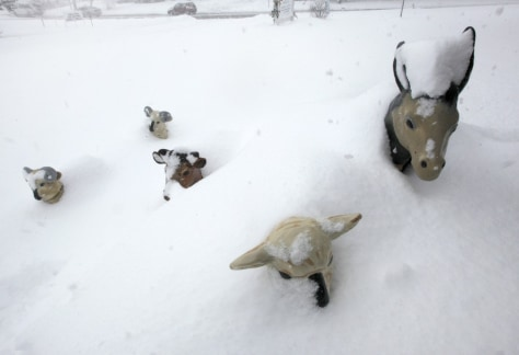 Image: Snow covers Christmas manger scene