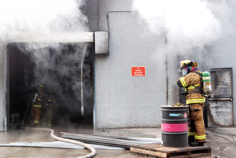 Image: Fireman battles fire at AL Solutions