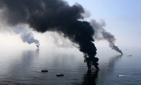 Image: Smoke billows from a controlled burn of spilled oil off the Louisiana coast in the Gulf of Mexico coast line