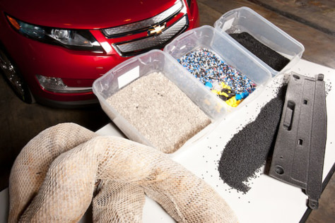Image: General Motors converts oil-soaked, plastic absorbent booms floating in the Gulf of Mexico into parts for the Chevrolet Volt