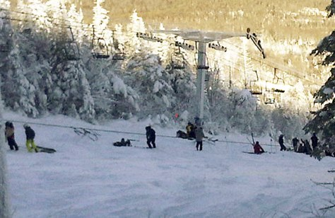 Image: Skiers and lift chairs after a lift derailed at Sugarloaf resort in Maine