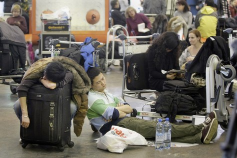 Image: Passengers rest on a floor of Shremetyevo international airport