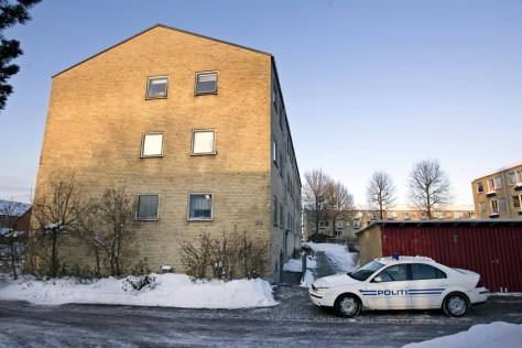 Image: Police patrol in front of apartments in Herlev, Denmark