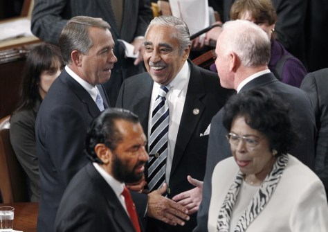 Newly elected Speaker of the House John Boehner (back, left) is greeted by Rep. Charles Rangel (back, center) and other members of Congress as he arrives on the House floor on the opening day of the 112th United States Congress in Washington on Wednesday.