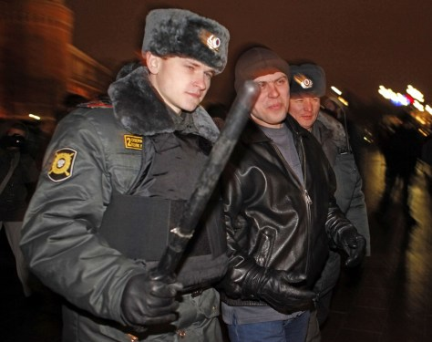 Image: Russian police officers detain a man suspected of planning a racist rally outside the Kremlin