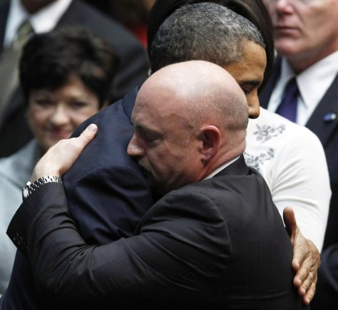 "Image: Giffords' husband Kelly hugs U.S. President Obama at ""Together We Thrive: Tucson and America"" event in tucson"