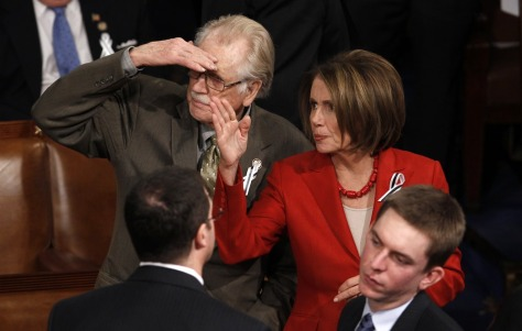 Image: Former Democratic Speaker of the House Pelosi takes her seat next to Republican Rep. Roscoe Bartlett before State of the Union address to a joint session of Congress on Capitol Hill in Washington