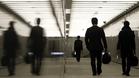 Image: Businessmen walking