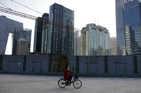 Image: Cyclist passes new consruction in Beijing