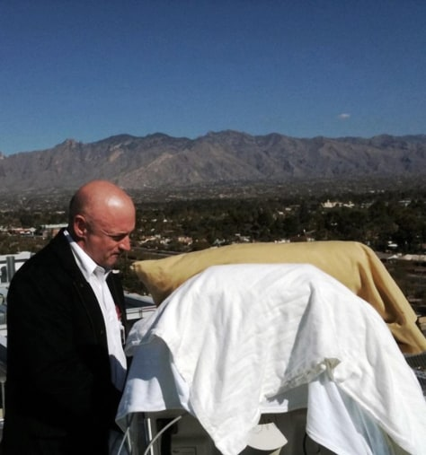 Image: Mark Kelly, stands with his wife Gabriell Giffords