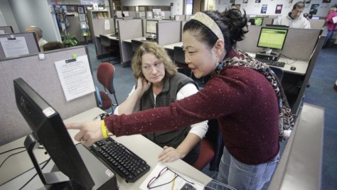 Image: Sun Gaddis, right, a career center specialist, helps job seeker Paula Morgan