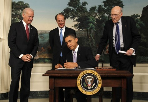 Image: U.S. President Obama signs an executive order at the White House in Washington