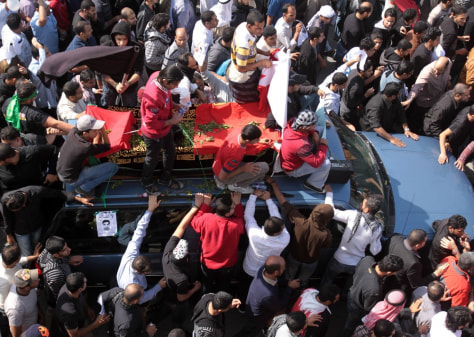 Image: A funeral procession for Ali Abdulhadi Mushaima, 21, moves slowly through the streets of Jidhafs, Bahrain, Tuesday