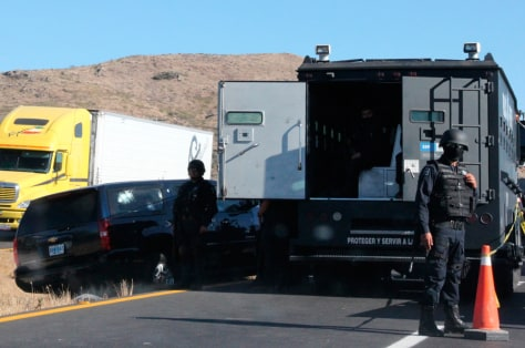 Image: A car of U.S. Immigration and Customs Enforcement agents is seen next to a truck in Ojo Caliente