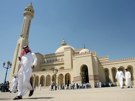 A Bahraini man uses his mobile phone as