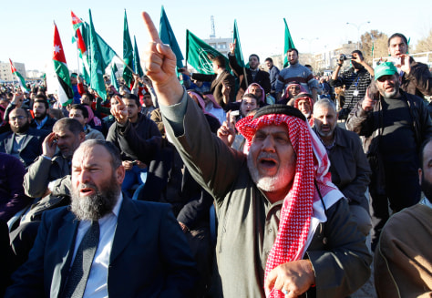 Image: Supporters of the Jordanian Muslim Brotherhood and Islamic Action Front party shout slogans during a rally in Amman