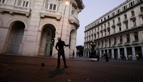 Image: A city employee sweeps streets in Old Havana, Cuba