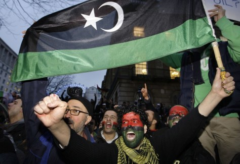 Image: Protesters with pre-1969 Libyan flag in London.