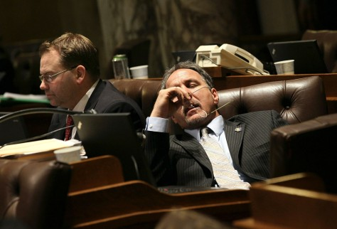 Image: Wisconsin State representatives start to fade as they listen to arguments on one of the expected 200 amendments to Gov. Scott Walker's budget repair bill in the early morning hours