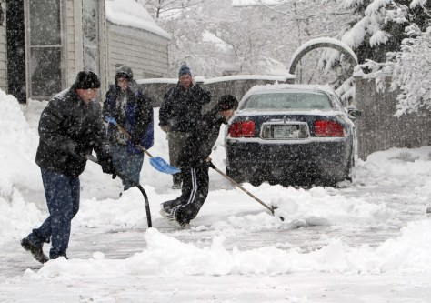Image: Father and son shovel snow in Concord, N.H.