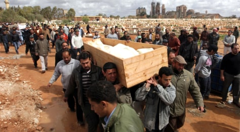 Image: Libyan protesters and relatives carry the coffin with the corpse of protester Esam Bishir Abdo Allah