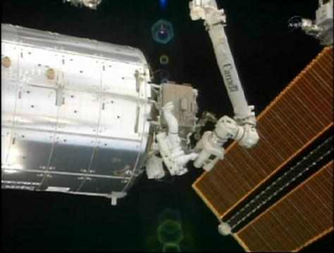 Image: Astronaut Steve Bowen works outside the Qwest airlock of the International Space Station.