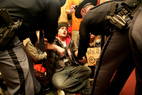 Image: Protesters removed by police from Wisconsin Assembly chamber