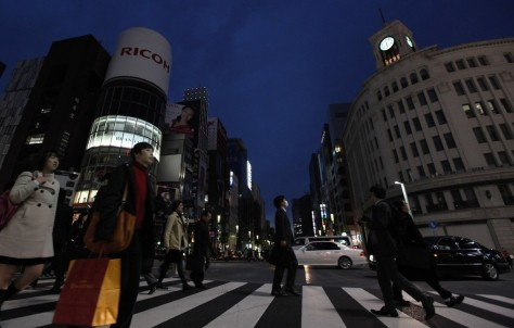 Image: City lights and billboards are turned off in Tokyo