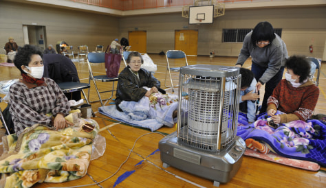 Evacuees gather at a shelter in the Japa