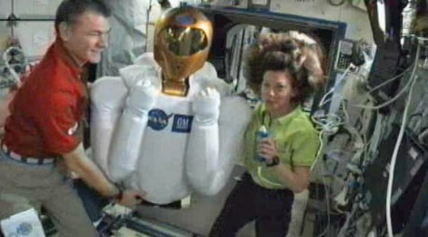 Image: two astronauts with Robonaut 2 bot