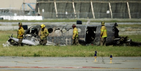 Image: Firefighters view the wreckage
