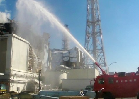 Image: Fire engine douses reactor number 3