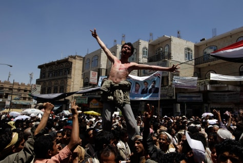 Image: Anti-government protesters shout slogans during a rally Wednesday to demand the ouster of Yemen President Ali Abdullah Saleh outside Sanaa University