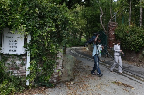 Image: A TV news crew at the site of a proposed mega-mansion in Benedict Canyon