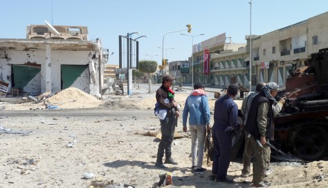 Image: Libyan rebel fighters are seen on Tripoli Street in the strategic western rebel-held port of Misrata