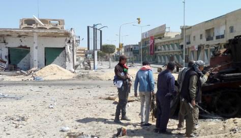 Image: Libyan rebel fighters are seen on Tripoli Street in the strategic western rebel-held port of Misrata
