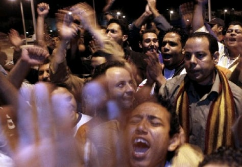 Image: Egyptians celebrate outside a Sharm el-Sheikh courthouse