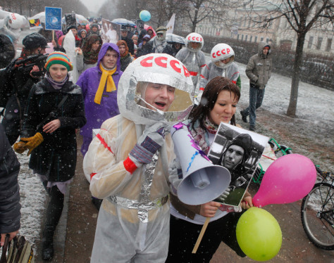 Image: People participate in a flashmob rally to mark the 50th anniversary of Yuri Gagarin's mission