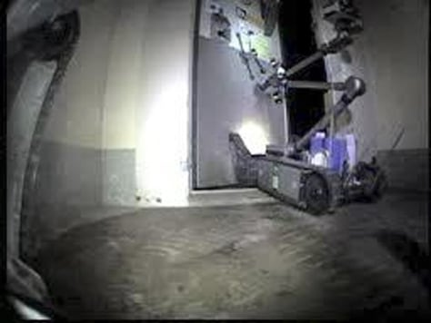 Image: Remote-controlled robot in the crippled Fukushima Dai-ichi No. 2 reactor building