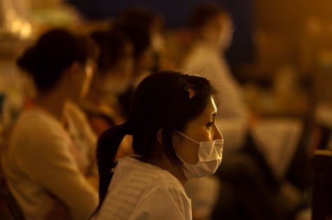 Image: Nurse Mariko Hino keeps watch over sleeping evacuees