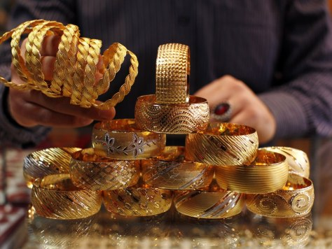 Image: A goldsmith displays gold bangles in his jewellery shop in Istanbul