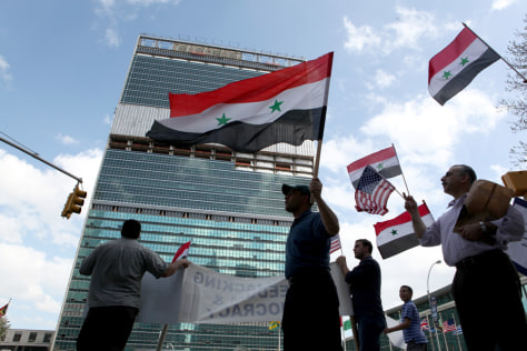 Image: Demonstrations near the United Nations building in New York support anti-government protesters in Syria