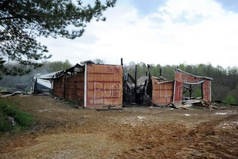 Image: The remains of Brent Whitehouse's barn in McConnelsville smolder