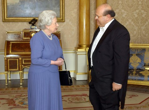 Image: Britain's Queen Elizabeth II; the Ambassador of Syria, Sami Khiyami